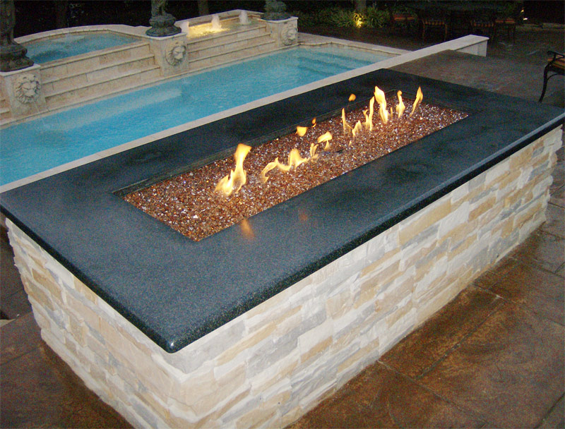 Copper Reflective Diamond Fire Glass installed in an outdoor fire pit - Copper Reflective Diamond Fire Pit Glass - 1 LB Crystal Package