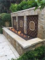 Copper Nugget Diamond Fire Pit Glass installed in outdoor fire feature