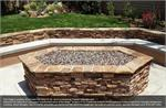 Tuscan Reserve Diamond Fire Pit Glass installed in an outdoor fire pit